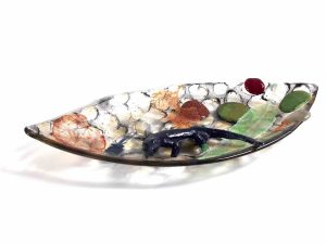 Photo of Wetlands, a fused glass bowl with glass leaves rocks and a small lizard